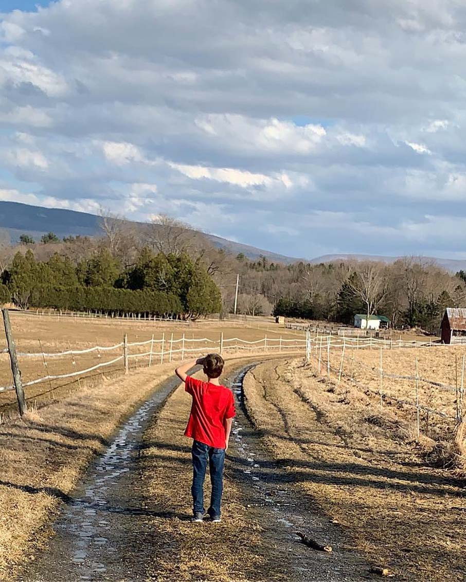 scenic drive kid on two track road landscape