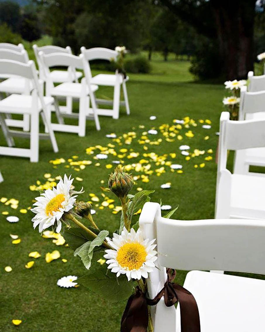 wedding in benningon vermont chairs and flower petals