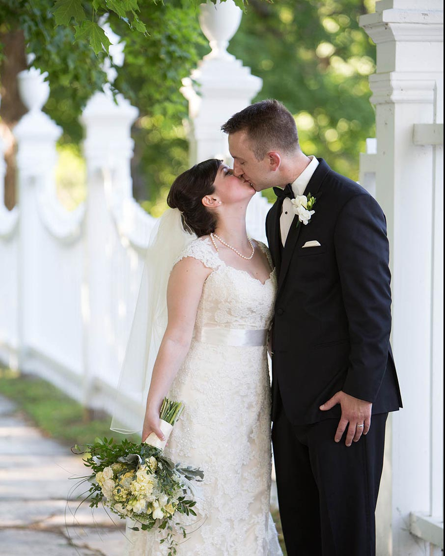 historic new england church fence wedding kiss