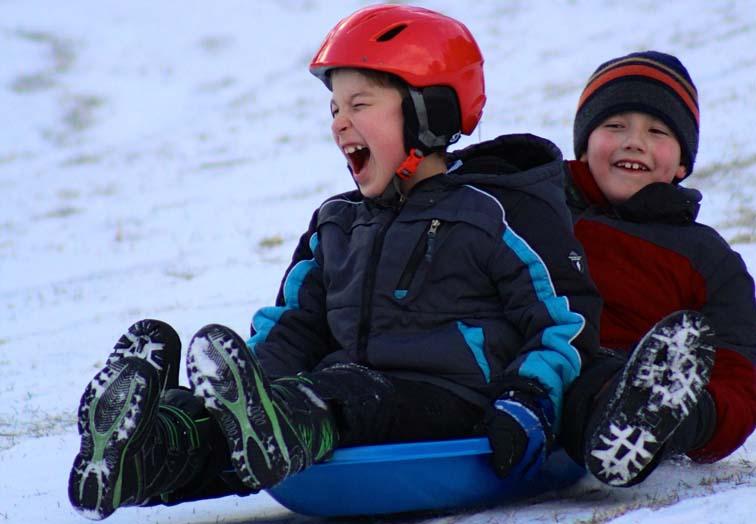 gleeful boys sledding winterfest vermont winter festival