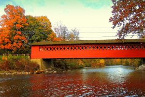 The Burt Henry Covered Bridge in North Bennington, VT in the fall