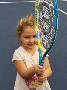 A young girl getting ready for a game of tennis. Photo credit: Bennington Tennis Center