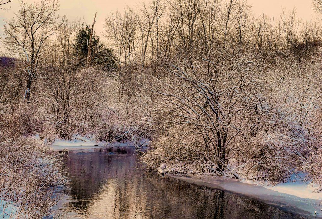 A winter scene featuring Greenberg Headwaters Park in Bennington, Vermont