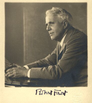 A black and white photo of Robert Frost with a signature.