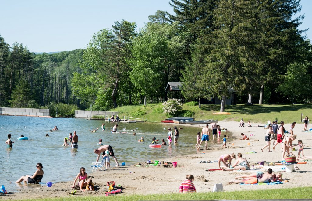 Swimmers and sun bathers at Lake Shaftsbury state Park in Shaftsbury, VT