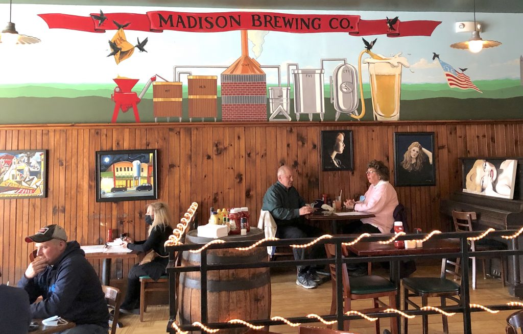 Diners enjoying food and drink at Madison Brewing Company in Bennington, VT.