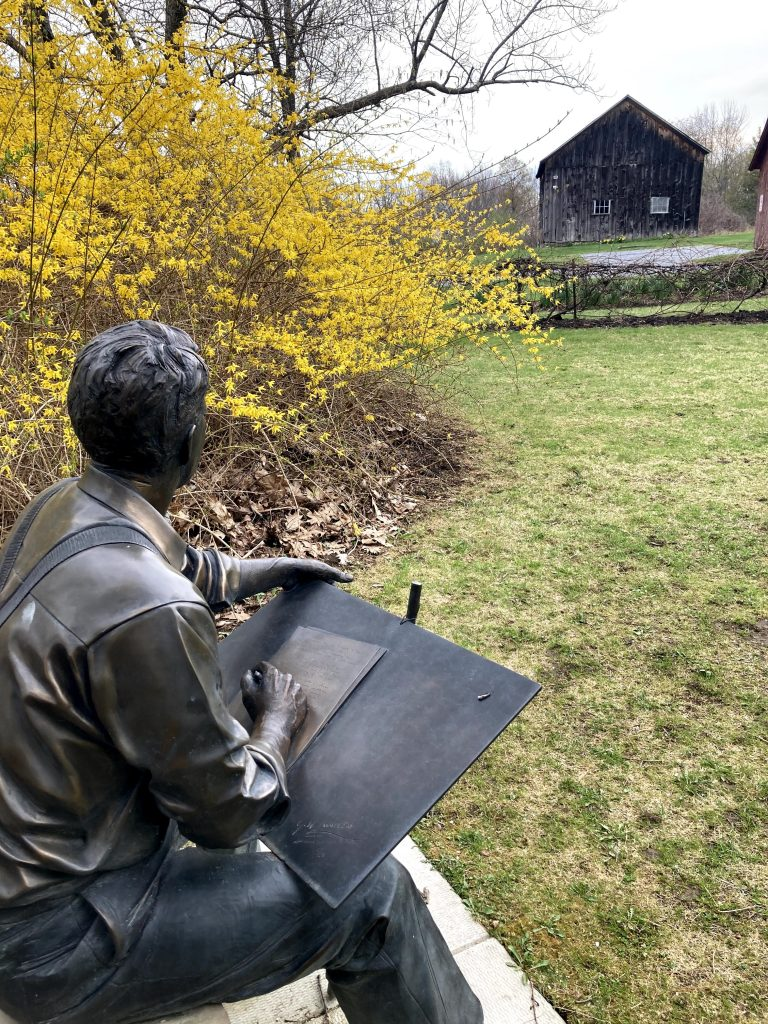 A bronze statue of Robert Frost at his former home in South Shaftsbury, Vermont.