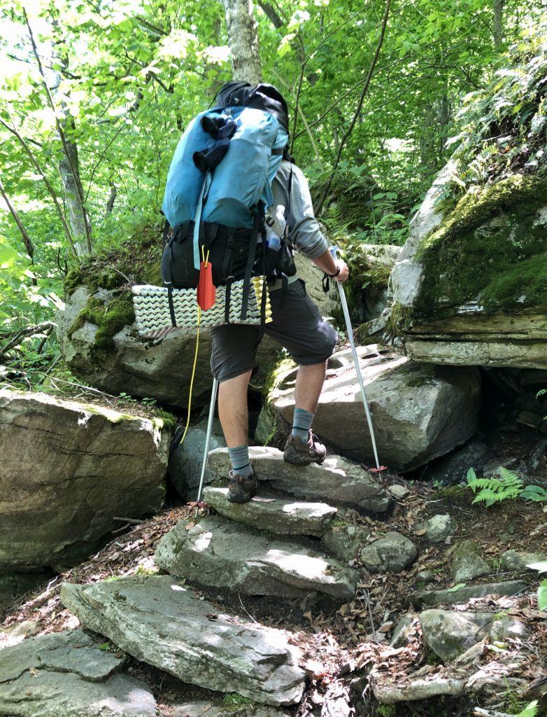 A man climbs steep steps on the Appalachian Trail near Bennington, Vermont.