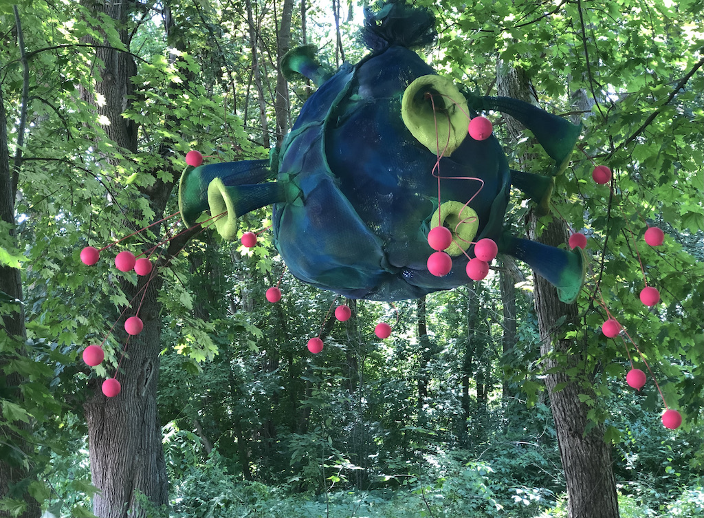 A hanging flower sculpture in the woods during the North Bennington Outdoor Sculpture Show in Vermont.